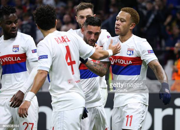 Memphis Depay of Lyon celebrates scoring the third goal with Jordan Ferri of Lyon during the UEFA Europa League group E match between Olympique...