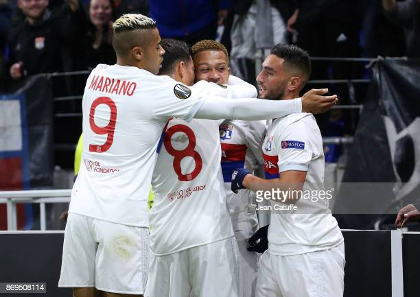 Memphis Depay of Lyon celebrates scoring the third goal with Mariano Diaz Houssem Aouar Jordan Ferri of Lyon during the UEFA Europa League group E...