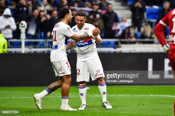 Memphis Depay of Lyon celebrates with Jordan Ferri after scoring a goal during the Ligue 1 match between Lyon and Amiens at Parc Olympique on April...