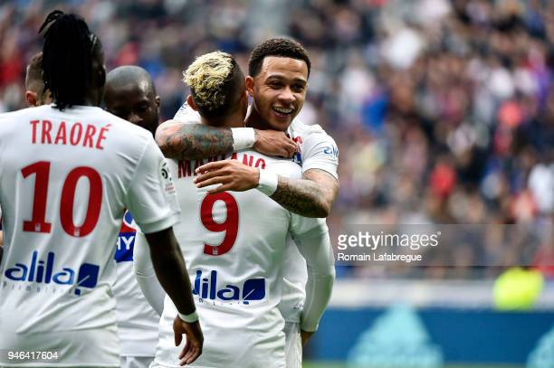 Memphis Depay of Lyon celebrates with Mariano Diaz of Lyon during the Ligue 1 match between Lyon and Amiens at Parc Olympique on April 14 2018 in Lyon