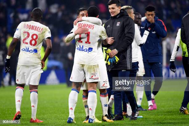 Memphis Depay of Lyon celebrates with Nabil Fekir of Lyon during the Ligue 1 match between Olympique Lyonnais and Paris Saint Germain at Groupama...