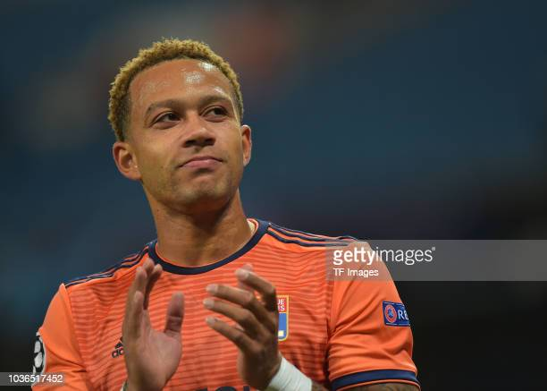 Memphis Depay of Lyon claps after the UEFA Champions League Group F match between Manchester City and Olympique Lyonnais at Etihad Stadium on...