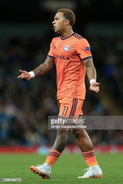 Memphis Depay of Lyon complains during the Group F match of the UEFA Champions League between Manchester City and Olympique Lyonnais at the Etihad...