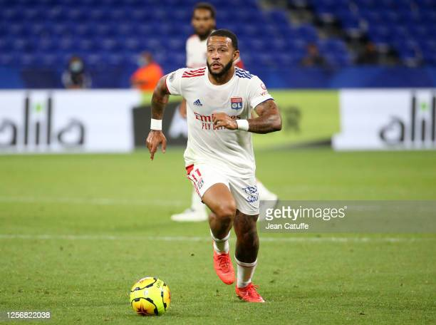 Memphis Depay of Lyon drives the ball during the Veolia Trophy friendly match between Olympique Lyonnais and Glasgow Rangers at Groupama Stadium on...