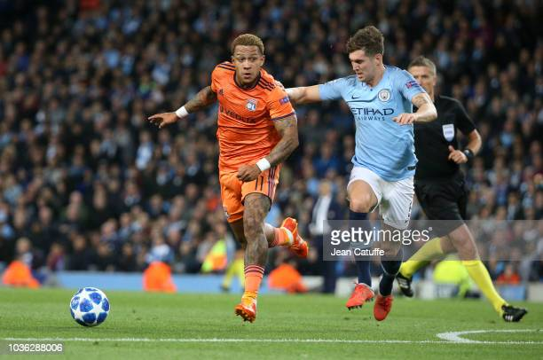 Memphis Depay of Lyon John Stones of Manchester City during the Group F match of the UEFA Champions League between Manchester City and Olympique...