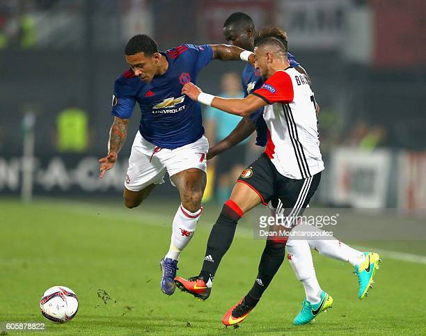 Memphis Depay of Manchester United and Bilal Basacikoglu of Feyenoord battle for the ball during the UEFA Europa League Group A match between...