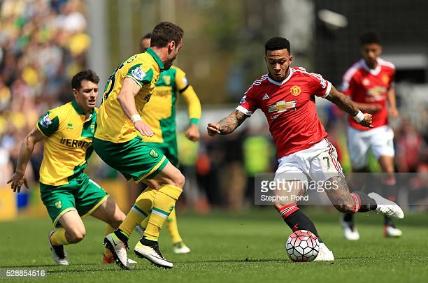 Memphis Depay of Manchester United and Ivo Pinto of Norwich City compete for the ball during the Barclays Premier League match between Norwich City...