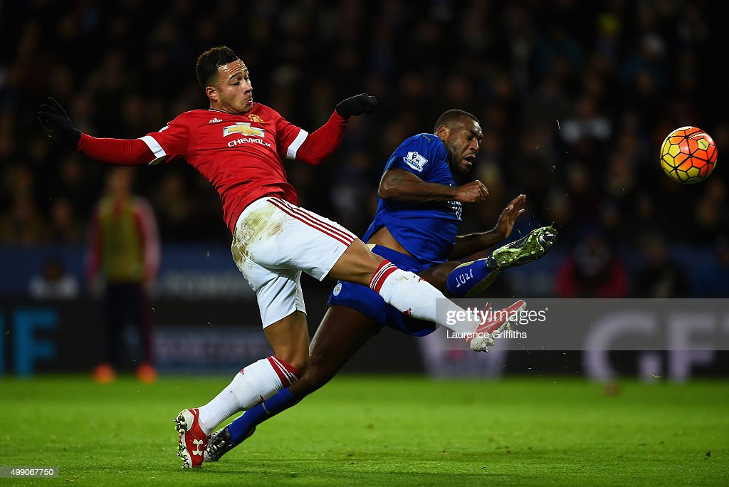 Memphis Depay of Manchester United and Wes Morgan of Leicester City compete for the ball during the Barclays Premier League match between Leicester City and Manchester United at The King Power Stadium on November 28, 2015 in Leicester, England.