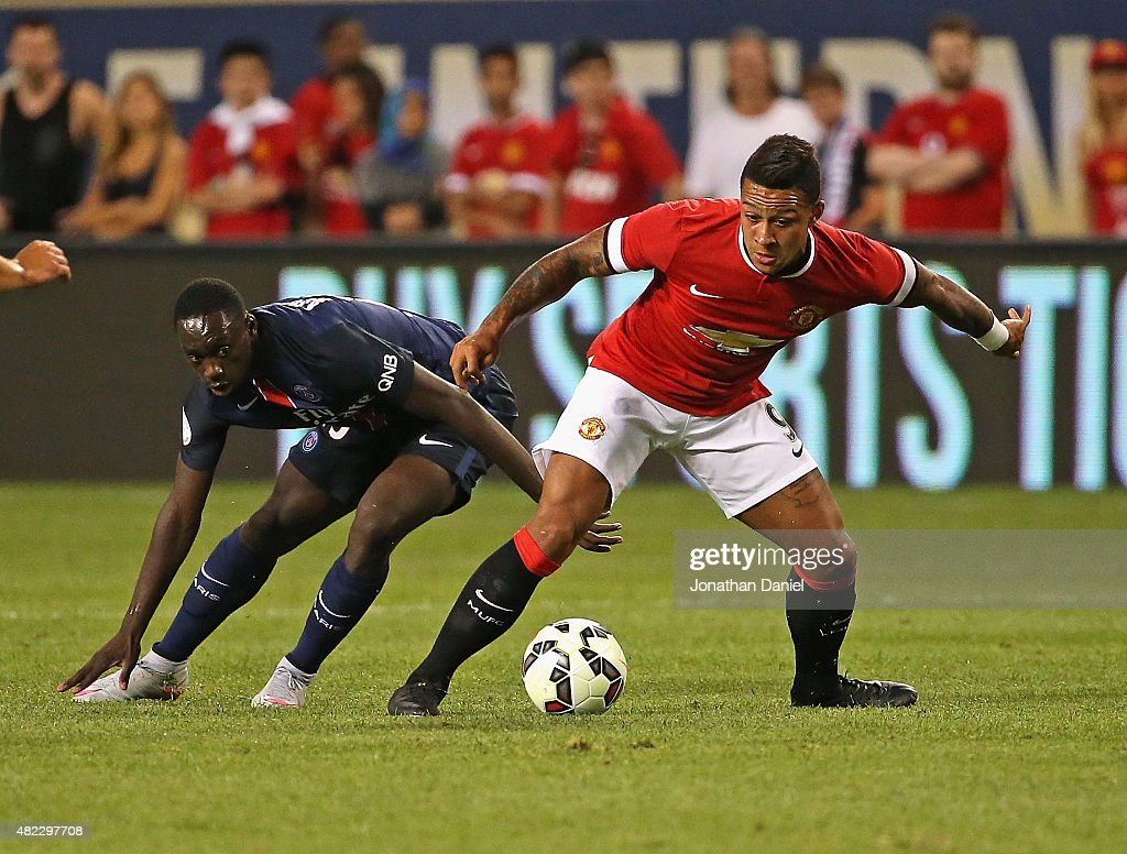 Memphis Depay #9 of Manchester United battle with Serge Aurier #19 of Paris Saint-Germain during a match in the 2015 International Champions Cup at Soldier Field on July 29, 2015 in Chicago, Illinois.