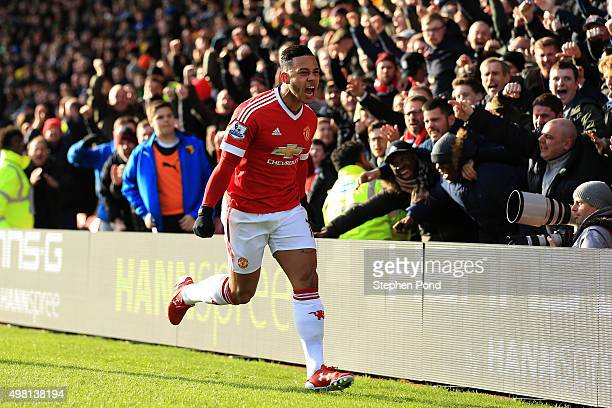 Memphis Depay of Manchester United celebrates scoring his team's first goal during the Barclays Premier League match between Watford and Manchester...