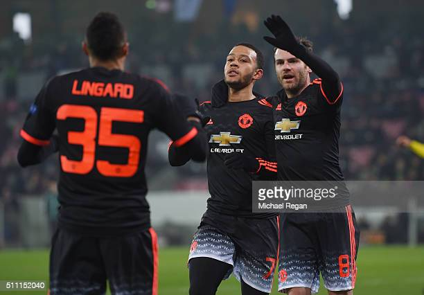 Memphis Depay of Manchester United celebrates scoring his team's first goal with his team mates Jesse Lingard and Juan Mata during the UEFA Europa...