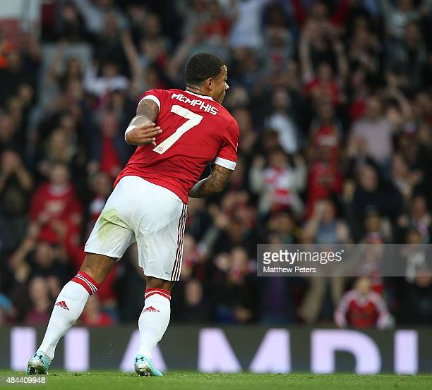 Memphis Depay of Manchester United celebrates scoring their first goal during the UEFA Champions League playoff first leg match between Manchester...