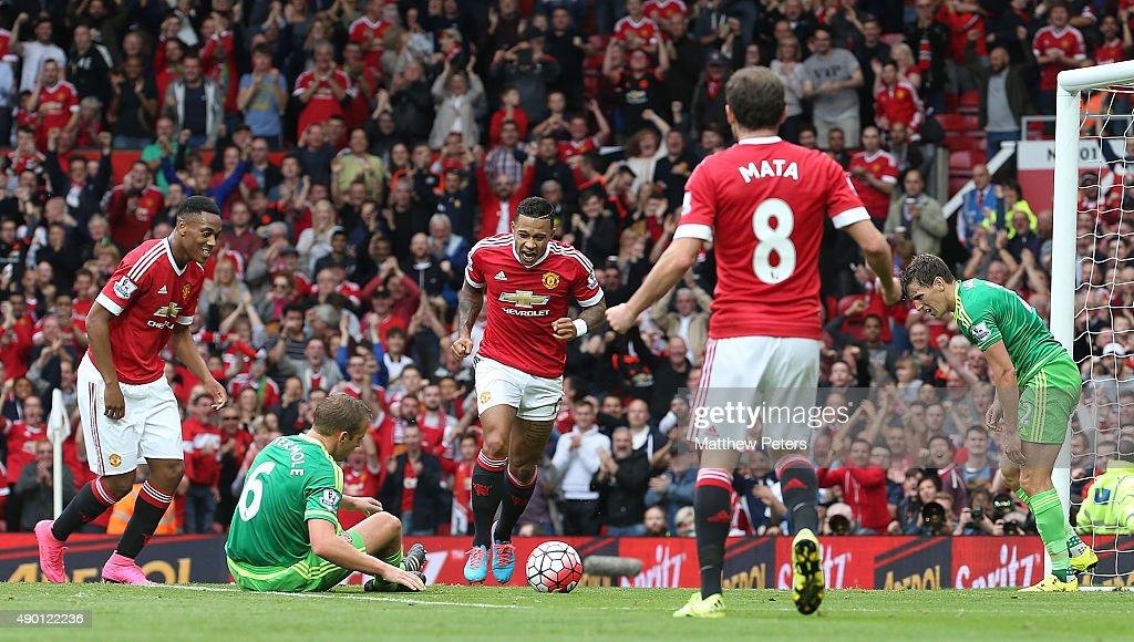 Memphis Depay of Manchester United celebrates scoring their first goal during the Barclays Premier League match between Manchester United and Sunderland on September 26, 2015 in Manchester, United Kingdom.