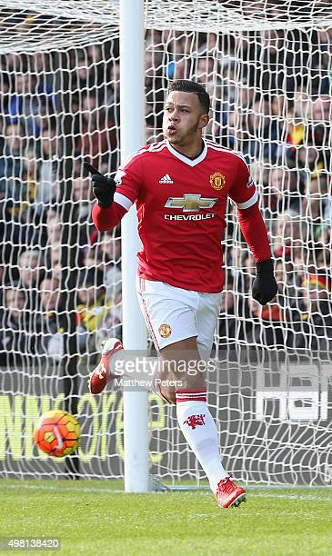 Memphis Depay of Manchester United celebrates scoring their first goal during the Barclays Premier League match between Watford and Manchester United...