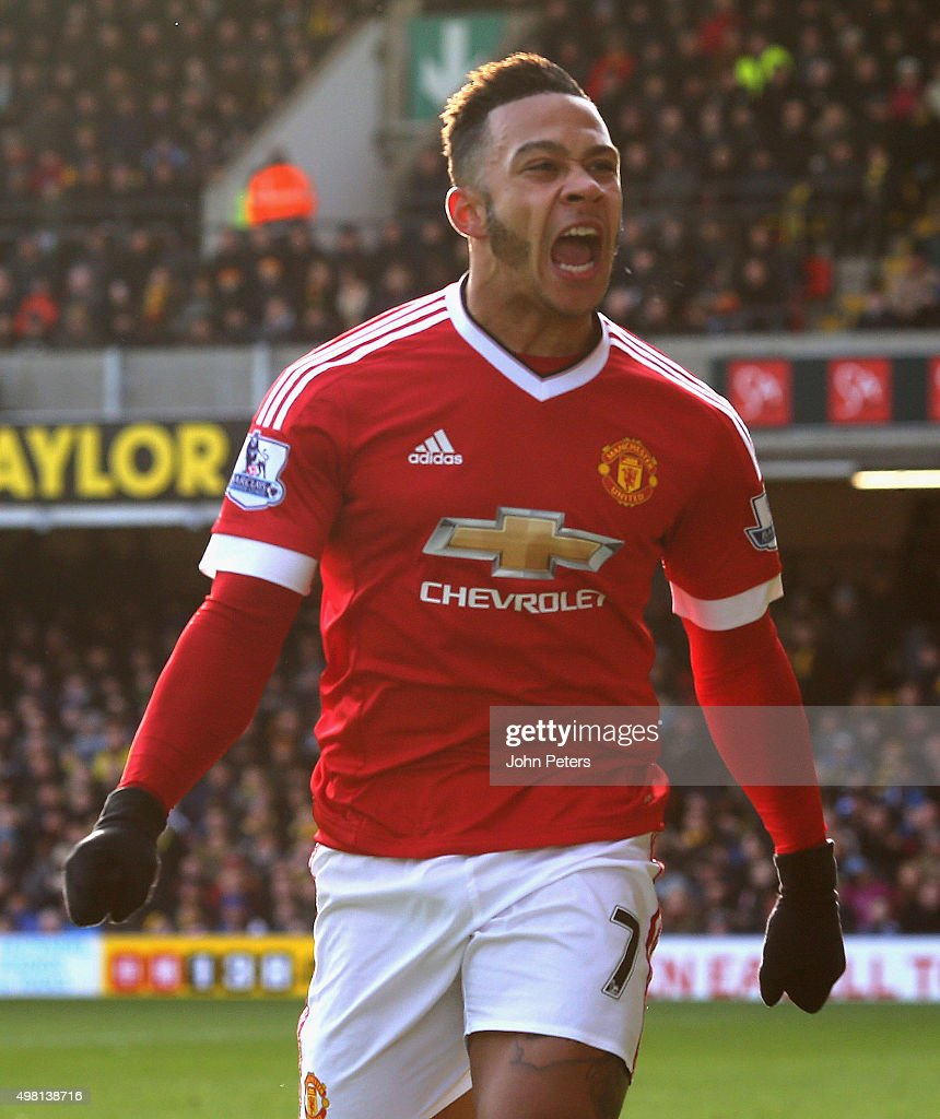 Memphis Depay of Manchester United celebrates scoring their first goal during the Barclays Premier League match between Watford and Manchester United at Vicarage Road on November 21, 2015 in Watford, England.