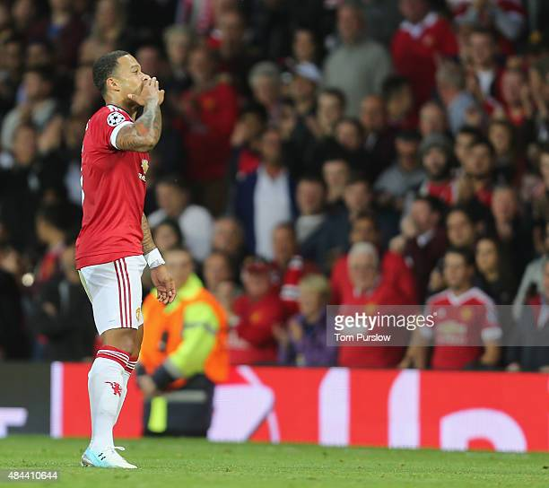 Memphis Depay of Manchester United celebrates scoring their second goal during the UEFA Champions League playoff first leg match between Manchester...