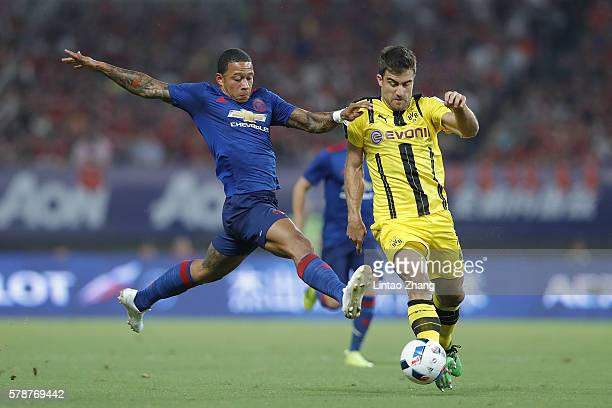 Memphis Depay of Manchester United competes for the ball with Sokratis Papastathopoulos of Borussia Dortmund during the International Champions Cup...