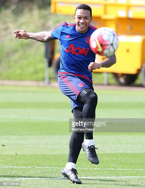Memphis Depay of Manchester United in action during a first team training session at Aon Training Complex on September 11 2015 in Manchester England