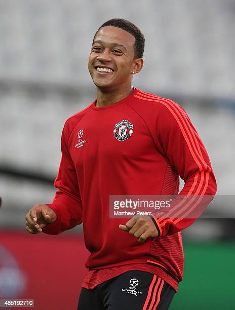 Memphis Depay of Manchester United in action during a first team training session ahead of their UEFA Champions League playoff second leg match...