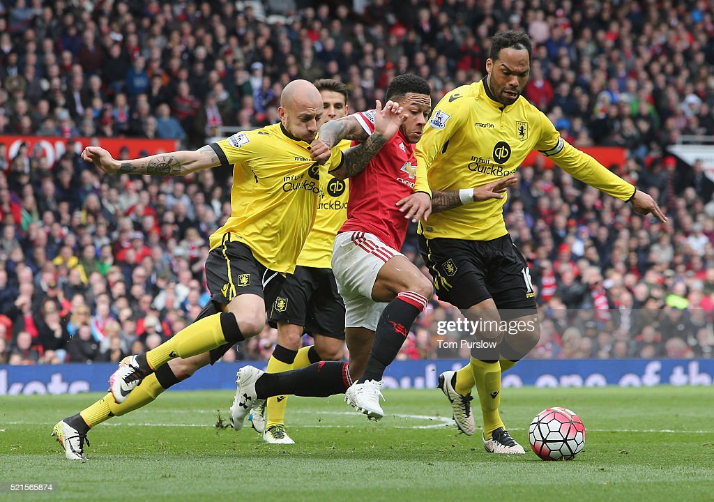 Memphis Depay of Manchester United in action with Alan Hutton and Joleon Lescott of Aston Villa during the Barclays Premier League match between Manchester United and Aston Villa at Old Trafford on April 16, 2016 in Manchester, United Kingdom.