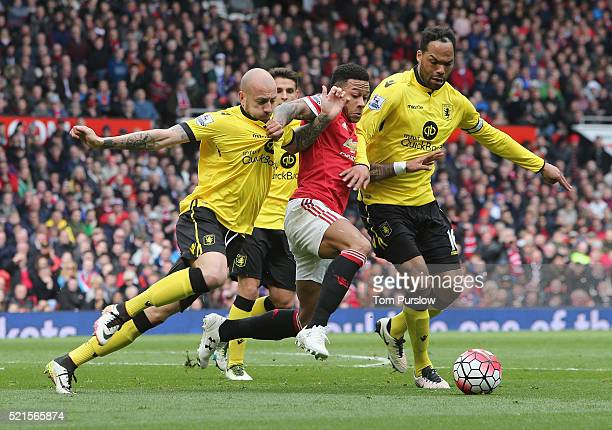 Memphis Depay of Manchester United in action with Alan Hutton and Joleon Lescott of Aston Villa during the Barclays Premier League match between...