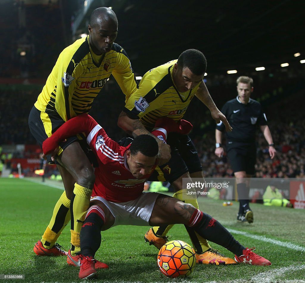 Memphis Depay of Manchester United in action with Allan Nyom and Troy Deeney of Watford during the Barclays Premier League match between Manchester United and Watford at Old Trafford on March 2, 2016 in Manchester, England.