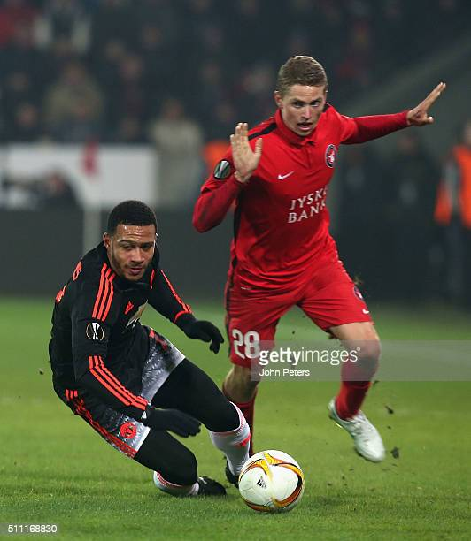 Memphis Depay of Manchester United in action with Andre Romer of FC Midtjylland during the UEFA Europe League match between FC Midtjylland and...