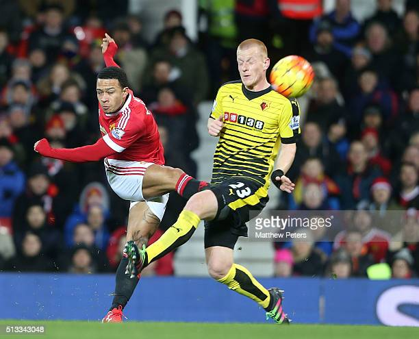Memphis Depay of Manchester United in action with Ben Watson of Watford during the Barclays Premier League match between Manchester United and...