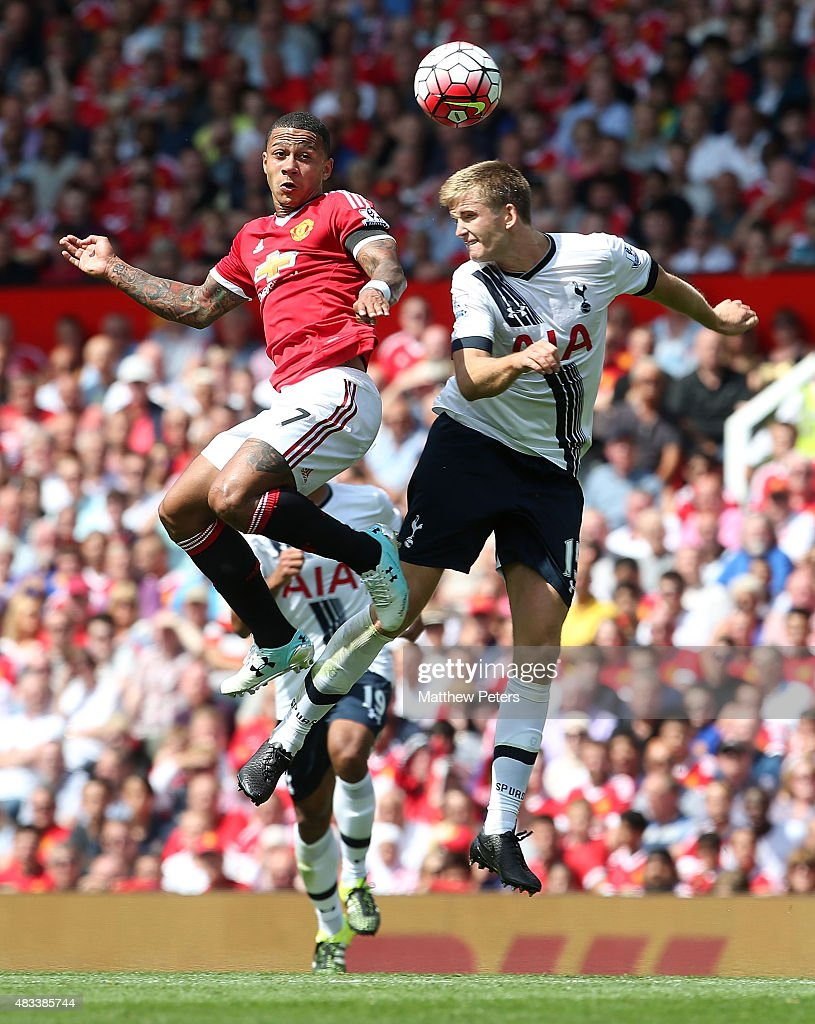 Memphis Depay of Manchester United in action with Eric Dier of Tottenham Hotspur during the Barclays Premier League match between Manchester United and Tottenham Hotspur at Old Trafford on 8 August 2015 in Manchester, England.