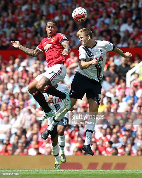 Memphis Depay of Manchester United in action with Eric Dier of Tottenham Hotspur during the Barclays Premier League match between Manchester United...