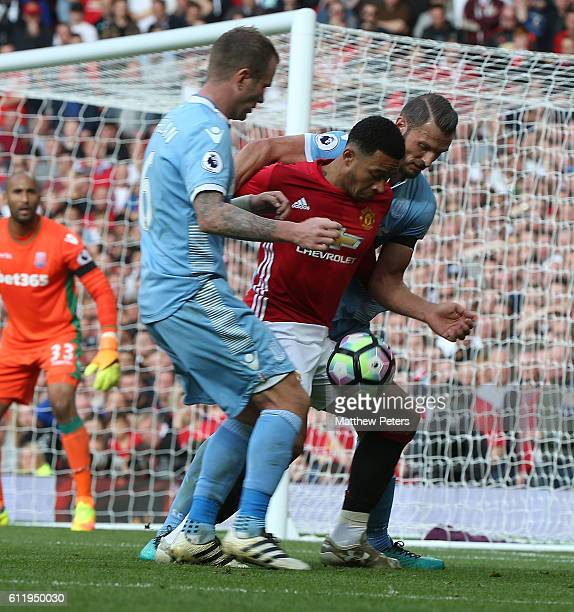 Memphis Depay of Manchester United in action with Erik Peters of Stoke City during the Premier League match between Manchester United and Stoke City...
