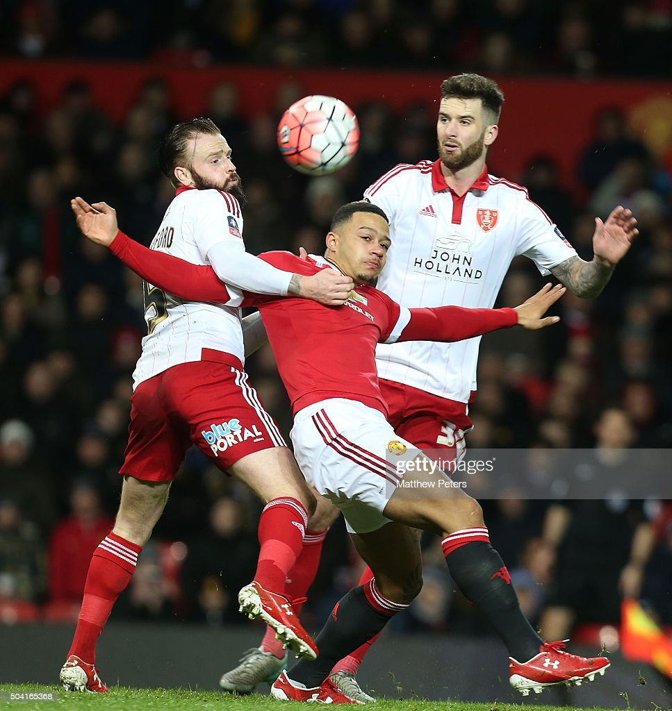 Memphis Depay of Manchester United in action with John Brayford and Dean Hammond of Sheffield United during the Emirates FA Cup Third round match between Manchester United and Sheffield United at Old Trafford on January 9, 2016 in Manchester, England.