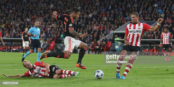 Memphis Depay of Manchester United in action with Jorrit Hendrix and Jeffrey Bruma of PSV Eindhoven during the UEFA Champions League match between...