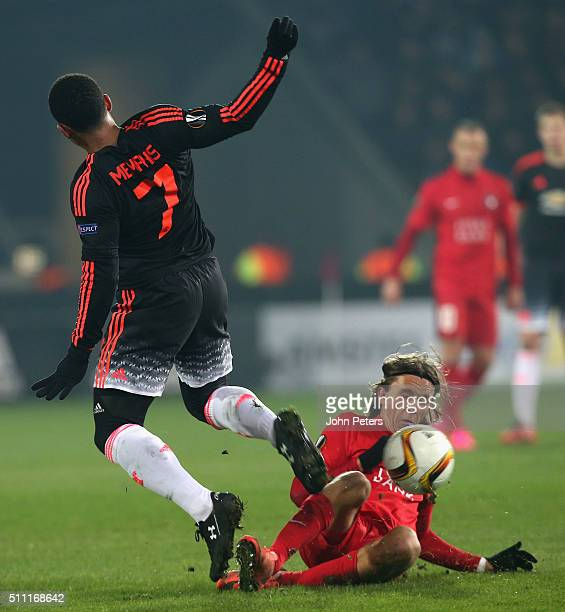Memphis Depay of Manchester United in action with Kristoffer Olsson of FC Midtjylland during the UEFA Europe League match between FC Midtjylland and...