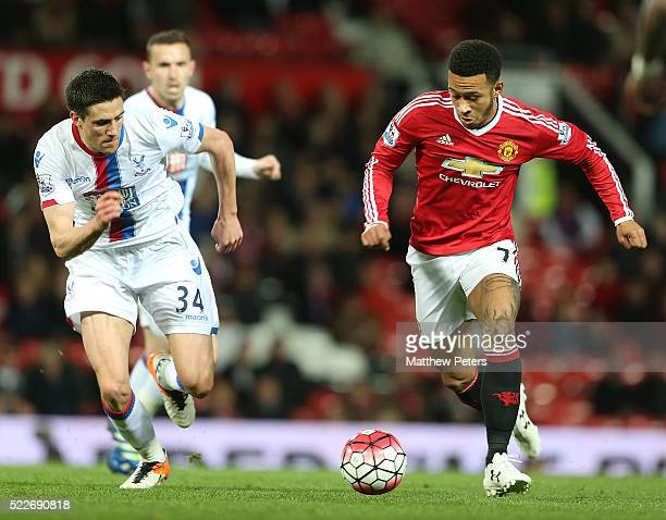 Memphis Depay of Manchester United in action with Martin Kelly of Crystal Palace during the Barclays Premier League match between Manchester United...