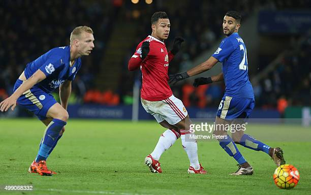 Memphis Depay of Manchester United in action with Ritchie de Laet and Riyad Mahrez of Leicester City during the Barclays Premier League match between...