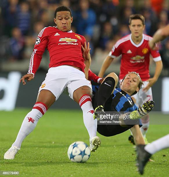 Memphis Depay of Manchester United in action with Ruud Vormer of Club Brugge during the UEFA Champions League playoff second leg match between Club...