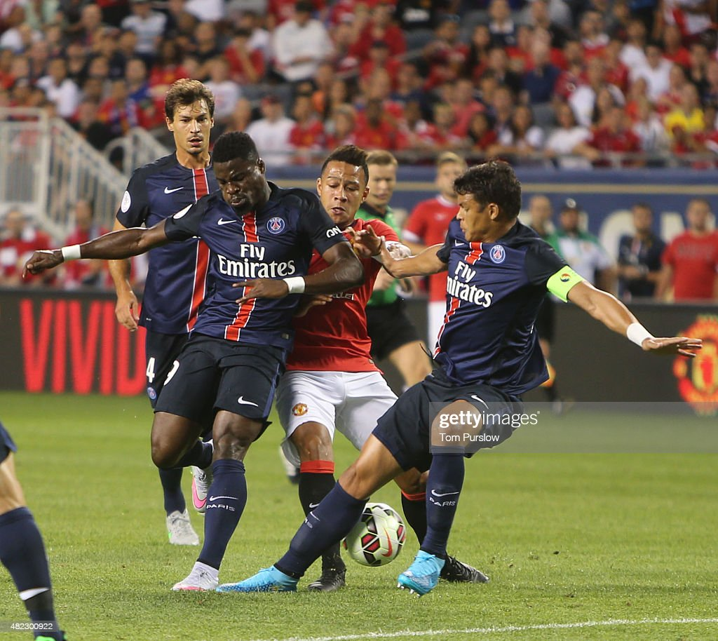 Memphis Depay of Manchester United in action with Serge Aurier (L) and Thiago Silva of Paris Saint Germain during the International Champions Cup 2015 match between Manchester United and Paris Saint Germain at Soldier Field on July 29, 2015 in Chicago, Illinois.