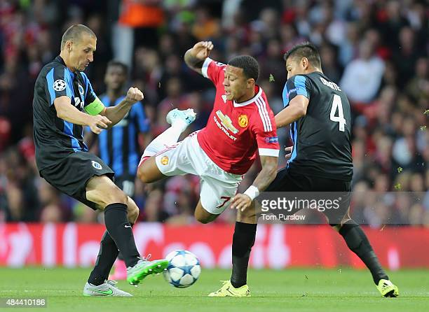 Memphis Depay of Manchester United in action with Timmy Simons and Oscar Duarte of Club Brugge during the UEFA Champions League playoff first leg...