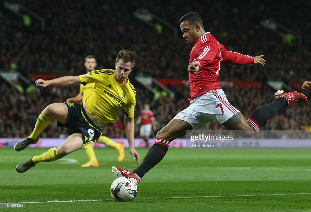 Memphis Depay of Manchester United in action with Tomas Kalas of Middlesbrough during the Capital One Cup Fourth Round match between Manchester United and Middlesbrough at Old Trafford on October 28, 2015 in Manchester, England.