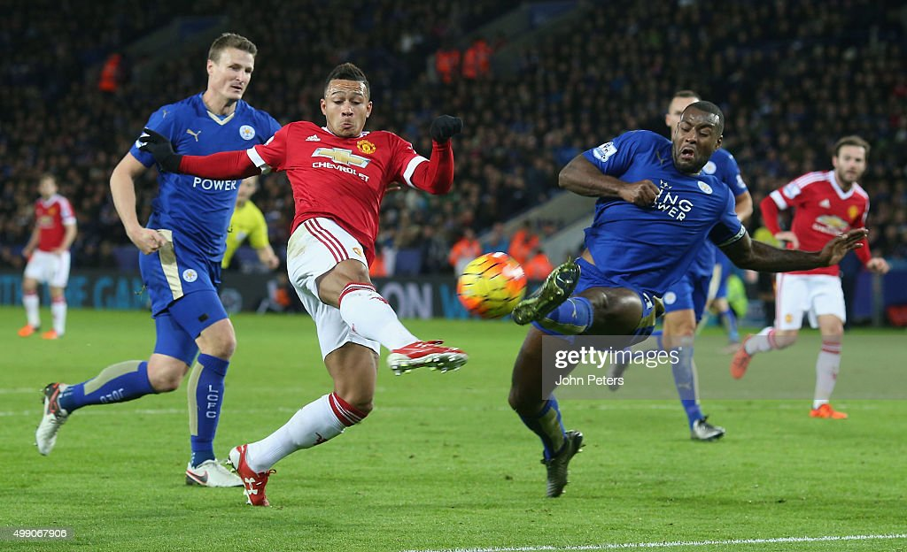 Memphis Depay of Manchester United in action with Wes Morgan of Leicester City during the Barclays Premier League match between Leicester City and Manchester United at The King Power Stadium on November 28, 2015 in Leicester, England.