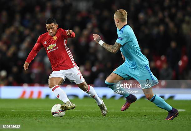 Memphis Depay of Manchester United is watched by Rick Karsdorp of Feyenoord during the UEFA Europa League Group A match between Manchester United FC...