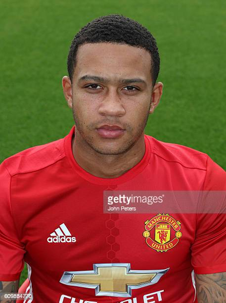 Memphis Depay of Manchester United poses for a portrait at the Manchester United Official Photocall on September 19 2016 in Manchester England