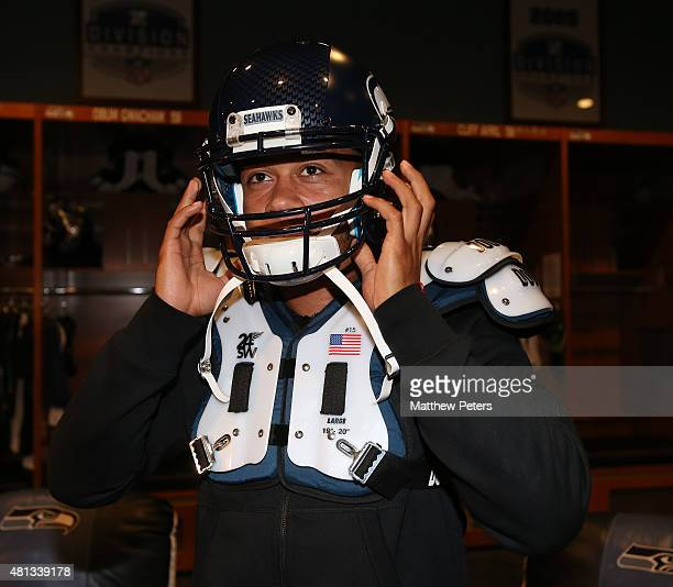 Memphis Depay of Manchester United tries on American Football kit during a visit to the Seattle Seahawks training facility during the club's...