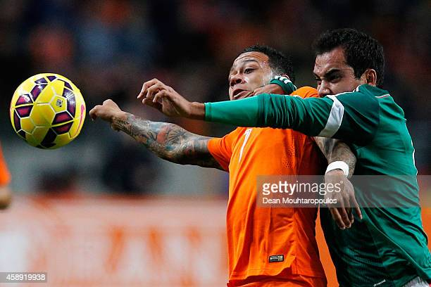 Memphis Depay of Netherlands and Adrian Aldrete of Mexico battle for the ball during the international friendly match between Netherlands and Mexico...
