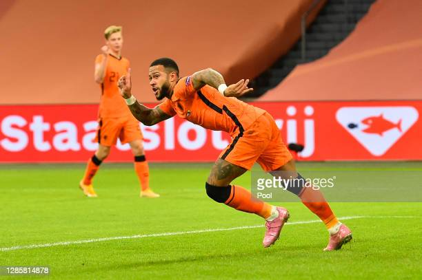 Memphis Depay of Netherlands celebrates after scoring his team's third goal during the UEFA Nations League group stage match between Netherlands and...