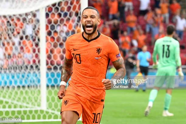 Memphis Depay of Netherlands celebrates after scoring their side's first goal during the UEFA Euro 2020 Championship Group C match between the...
