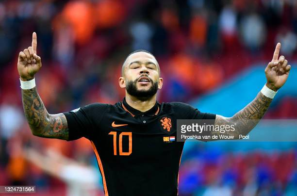 Memphis Depay of Netherlands celebrates after scoring their side's first goal during the UEFA Euro 2020 Championship Group C match between North...