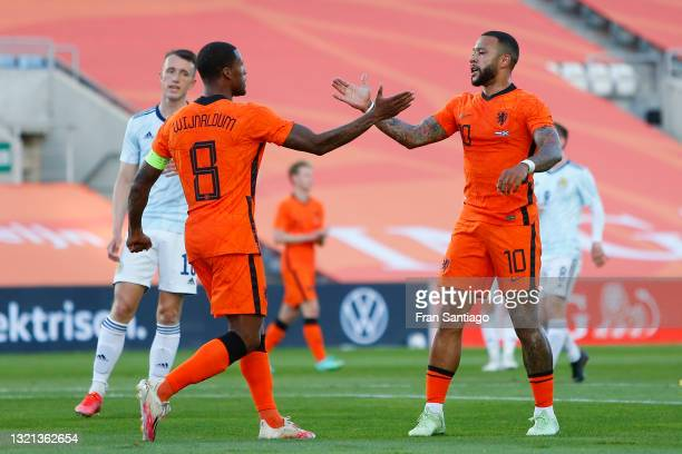 Memphis Depay of Netherlands celebrates with Georginio Wijnaldum after scoring their side's first goal during the international friendly match...