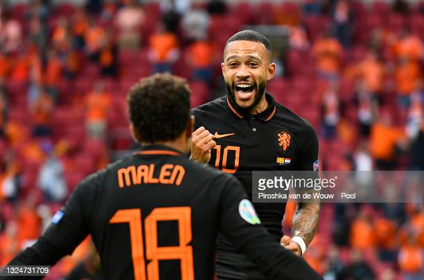 Memphis Depay of Netherlands celebrates with teammate Donyell Malen after scoring their side's first goal during the UEFA Euro 2020 Championship...